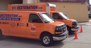 Water Damage Cleanup Vans At Job Location