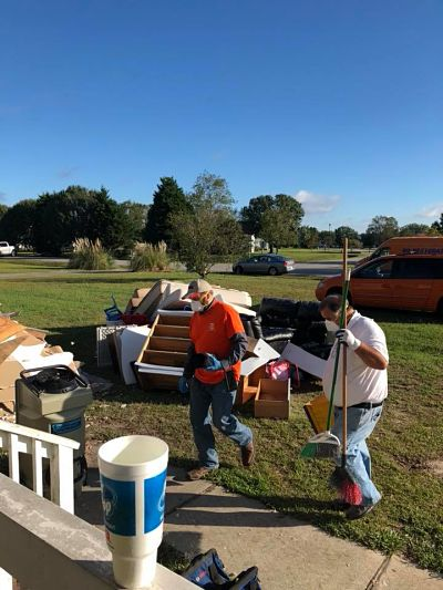 Technicians Conducting Flood Cleanup Services